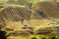 High voltage power lines running down a hillside in Eastern Washington, USA.