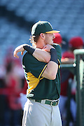 ANAHEIM, CA - AUGUST 29:  Josh Donaldson #20 of the Oakland Athletics stretches during batting practice before the game against the Los Angeles Angels of Anaheim at Angel Stadium on Saturday, August 30, 2014 in Anaheim, California. The Angels won the game in a 2-0 shutout. (Photo by Paul Spinelli/MLB Photos via Getty Images) *** Local Caption *** Josh Donaldson