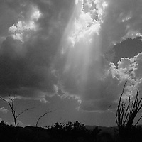A shaft of sunlight breaking through the clouds, along the Apache Trail