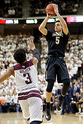 Vanderbilt's Matthew Fisher-Davis attempts a three point shot over Texas A&M's Admon Gilder (3) during the second half of an NCAA college basketball game, Saturday, March 5, 2016, in College Station, Texas. Texas A&M won 76-67. (AP Photo/Sam Craft)