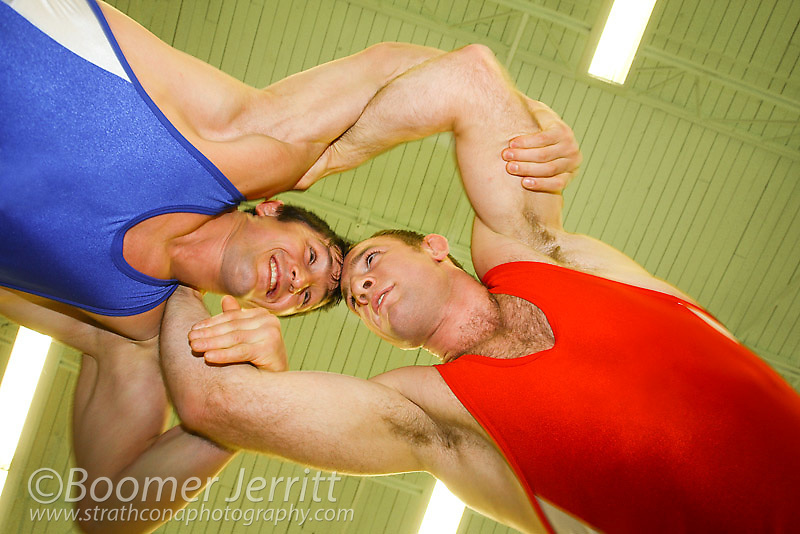 Two wrestler's begin they're bout in an armlock position during a practice match.  Port Alberni, Vancouver Island, British Columbia, Canada.