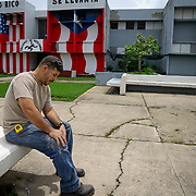 JULY 19, 2018----BAYAMON, PUERTO RICO---<br /> Inmate Joseph Villalobos sits in the yard in the Bayamon Correctional Complex which is made up of four buildings. The Puerto Rico Corrections and Rehabilitation Department is in the middle of a project to downsize by transferring inmates to private jails in the United States and closing institutions like this.<br /> (Photo by Angel Valentin/Freelance)