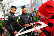 AFC Bournemouth forward Joshua King and AFC Bournemouth midfielder Junior Stanislas sign their autographs for fans before the Barclays Premier League match between Bournemouth and Arsenal at the Goldsands Stadium, Bournemouth, England on 7 February 2016. Photo by Graham Hunt.