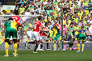 The Norwich players look dejected as the Man Utd players run off to celebrate what turns out to be the winning goal during the Barclays Premier League match at Carrow Road, Norwich<br /> Picture by Paul Chesterton/Focus Images Ltd +44 7904 640267<br /> 07/05/2016
