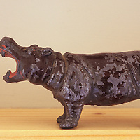 Model hippopotamus on shelf