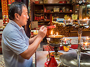 06 JUNE 2015 - KUALA LUMPUR, MALAYSIA:  People pray at the Sin Ze Si Ze Temple in Kuala Lumpur. It is the oldest Taoist temple in KL. It's named after patron deities Sin Sze Ya and Si Sze Ya, real people who were heros for fighting against Malay native in the early days of Kuala Lumpur.  PHOTO BY JACK KURTZ