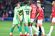 Tempers flare between Matty Kosylo of Halifax Town (7) and Nick Haughton of Salford City (7) after a foul during the Vanarama National League match between Salford City and FC Halifax Town at Moor Lane, Salford, United Kingdom on 14 August 2018.