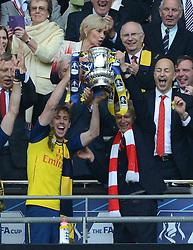 Arsenal's Nacho Monreal and Arsenal Manager, Arsene Wenger celebrate with the FA Cup - Photo mandatory by-line: Dougie Allward/JMP - Mobile: 07966 386802 - 30/05/2015 - SPORT - Football - London - Wembley Stadium - Arsenal v Aston Villa - FA Cup Final