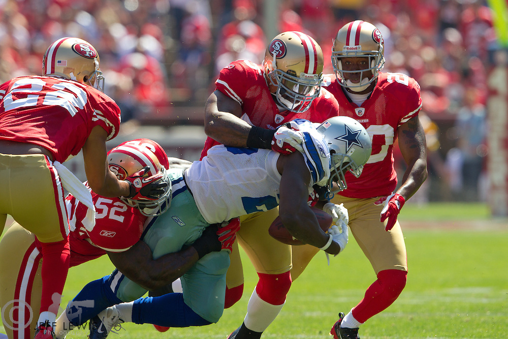 18 September 2011: The San Francisco 49ers defense tackles runingback  (28) Felix Jones of the Dallas Cowboys during the first half of the Cowboys 27-24 overtime victory against the 49ers in an NFL football game at Candlestick Park in San Francisco, CA