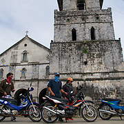 Bikers prepare to mount their rides parked outside the Baclayon Stone church on Bohol