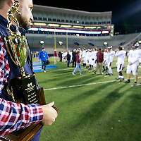 Thomas Wells | Buy at PHOTOS.DJOURNAL.COM<br /> Adam Dillinger gets ready to present the East Webster Wolverines with their second place trophy on Friday in Oxford.