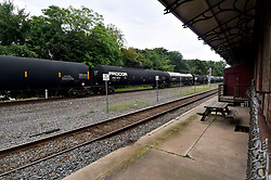 Freight train operated by Norfolk Southern roll past the former train station in Phoenixville, PA, on august 21, 2018. (Bastiaan Slabbers for WHYY)