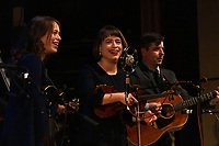 """The 59th Annual University of Chicago Folk Festival was held this weekend, Friday, February 15, 2019 and Saturday, February 16th, 2019 at the University of Chicago. The event was sponsored by The University of Chicago Folklore Society.<br /> <br /> 6844, 6879, 6884 – The Price Sisters perform a bluegrass set Friday, February 15th, 2019 at Mandel Hall located at 1132 E. 57th Street.<br /> <br /> Please 'Like' """"Spencer Bibbs Photography"""" on Facebook.<br /> <br /> Please leave a review for Spencer Bibbs Photography on Yelp.<br /> <br /> Please check me out on Twitter under Spencer Bibbs Photography.<br /> <br /> All rights to this photo are owned by Spencer Bibbs of Spencer Bibbs Photography and may only be used in any way shape or form, whole or in part with written permission by the owner of the photo, Spencer Bibbs.<br /> <br /> For all of your photography needs, please contact Spencer Bibbs at 773-895-4744. I can also be reached in the following ways:<br /> <br /> Website – www.spbdigitalconcepts.photoshelter.com<br /> <br /> Text - Text """"Spencer Bibbs"""" to 72727<br /> <br /> Email – spencerbibbsphotography@yahoo.com<br /> <br /> #SpencerBibbsPhotography <br /> #HydePark <br /> #Community <br /> #Neighborhood<br /> #CanonUSA"""