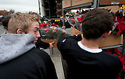 Cottonwood High School baseball players unload poinsettias to deliver to veterans at the George E. Wahlen Department of Veterans Affairs Medical Center, Wednesday, Dec. 5, 2012.