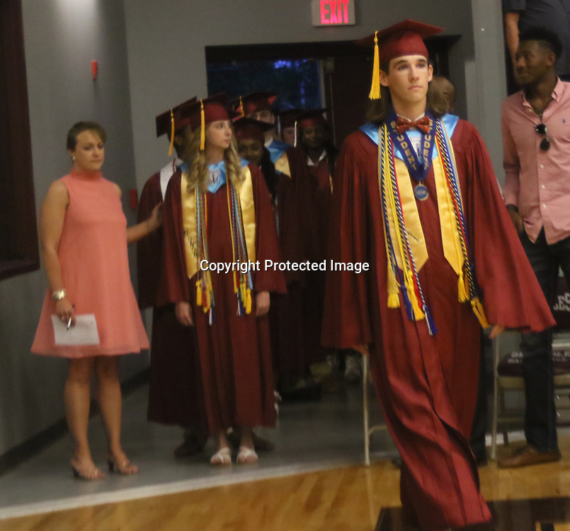 Smithville High School Valedictorian Brandon Blair leads the precession during the school's graduation.