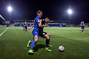 AFC Wimbledon Jack Rudoni (12) battles for possession with Brighton and Hove Albion midfielder Andrew Crofts (48) during the EFL Trophy (Leasing.com) match between AFC Wimbledon and U23 Brighton and Hove Albion at the Cherry Red Records Stadium, Kingston, England on 3 September 2019.
