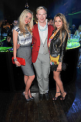 Left to right, NOELLE RENO, HENRY CONWAY and ZARA MARTIN at a party to launch the Dom Perignon Luminous label held at No.1 Mayfair, London on 24th May 2011.