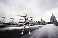 Female Athlete with javelin standing in front of St Paul's Cathedral in London