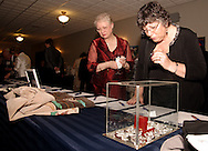 (from right) Mary Ann Bernstein of Dayton and Pam Eyink of Dayton look over items in the silent auction during The Masterpiece Ball, an evening with the Great Chefs, the 2010 2009 Opera Guild Gala at the Dayton Masonic Center, Saturday, March 13, 2010.