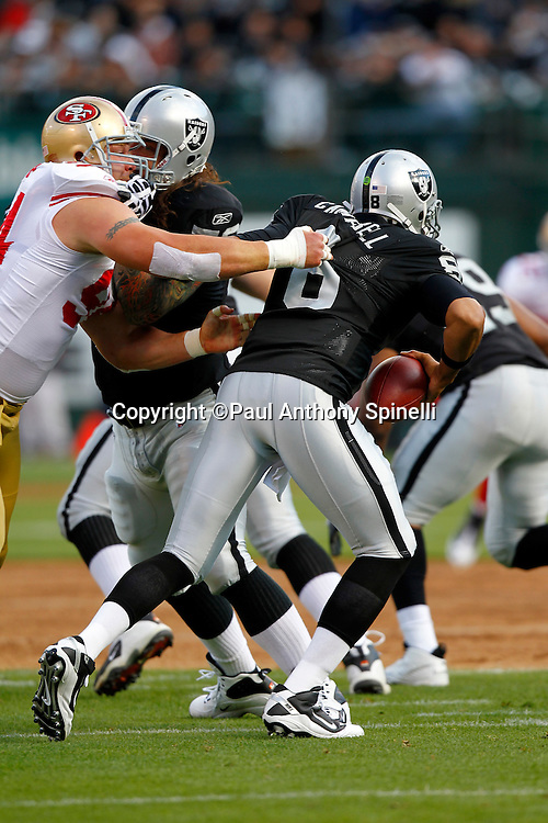 Oakland Raiders quarterback Jason Campbell (8) scrambles away from a sack attempt by San Francisco 49ers linebacker Travis LaBoy (54) during the NFL preseason week 3 football game against the San Francisco 49ers on Saturday, August 28, 2010 in Oakland, California. The 49ers won the game 28-24. (©Paul Anthony Spinelli)