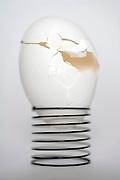a broken egg shell on a metal spring