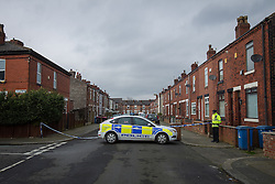 © Licensed to London News Pictures . 06/03/2014 . Eccles , UK . Police and crime scene investigators at the scene where a 24-year-old woman was found dead this morning (Thursday 6th March 2014) , on Holt Street in Eccles , Greater Manchester . Greater Manchester Police say they have launched a murder investigation and have arrested a 25-year-old man . Photo credit : Joel Goodman/LNP