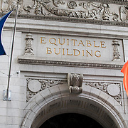 March 14, 2018 - New York, NY : The century-old Equitable Building, whose construction atop an entire city block at 120 Broadway in Lower Manhattan inspired the establishment of zoning regulations, has been undergoing a series of changes including the recent creation of a public hearing room for the Department of City Planning. Further renovation by the building's owner, Silverstein Properties, to be carried out by the architecture firm Beyer Blinder Belle and the landscape architecture firm MPFP, are also underway. Here, a view of the building's entrance on Broadway.  CREDIT: Karsten Moran for The New York Times