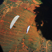 149 of the World's best paragliding pilots from 39 nations descended on the small country town of Manilla near Tamworth in northern New South Wales, Australia to contest the 10th FAI Paragliding World Championships during March 2007. The drought stricken area is renowned for it's great cross country flying from the Mount Borah hillside and over two hectic weeks, numerous incidents and mixed weather, the pilots were able to fly five tasks to decide the winners in what proved to be an extremely close contest.. The Men's competition was won by Great British pilot Bruce Goldsmith with Jean-Marc Caron of France finishing second just seventeen points behind with Thomas Mccune of USA finishing third. The women's competition was won by Petra Slivova of Czech Republic with Viv Williams of Australian just fifteen points behind and New Zealand pilot Harmony Gaw finishing third. .In the team event Czech Republic finished first followed by France and Switzerland....A view looking down from a tandem Paraglider during competition.