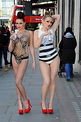Two models pose for photos as award-winning body artist Carolyn Roper paints them as Diet Coke bottles, recreating Jean Paul Gaultier's latest 'Night & Day' designs for the brand at Harvey Nichols in London, Monday 16th April   Photo by: Chris Joseph / i-Images