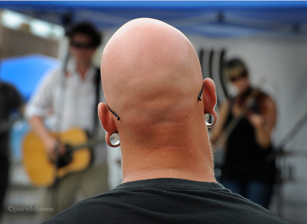 "ALL EARS: A fan listens to the ""Clumsy Lovers"" modern roots-folk/Celtic band at the Absarokee MT BBQ Festival. A snap from a toe-tapping, BBQ-eating afternoon in Montana. 1 July 2012."
