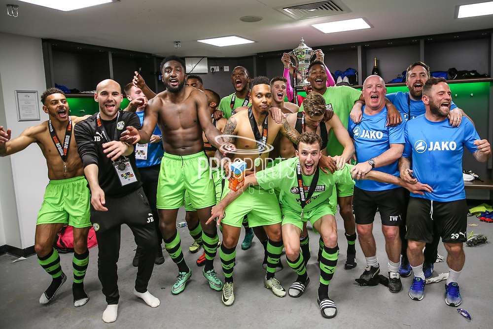 FGR players celebrate in the dressing room during the Vanarama National League Play Off Final match between Tranmere Rovers and Forest Green Rovers at Wembley Stadium, London, England on 14 May 2017. Photo by Shane Healey.