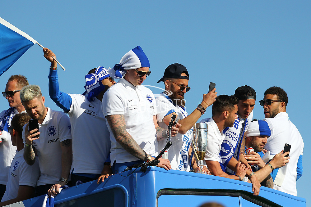 Players take selfies on the open top bus during the Brighton & Hove Albion Football Club Promotion Parade at Brighton Seafront, Brighton, East Sussex. United Kingdom on 14 May 2017. Photo by Ellie Hoad.
