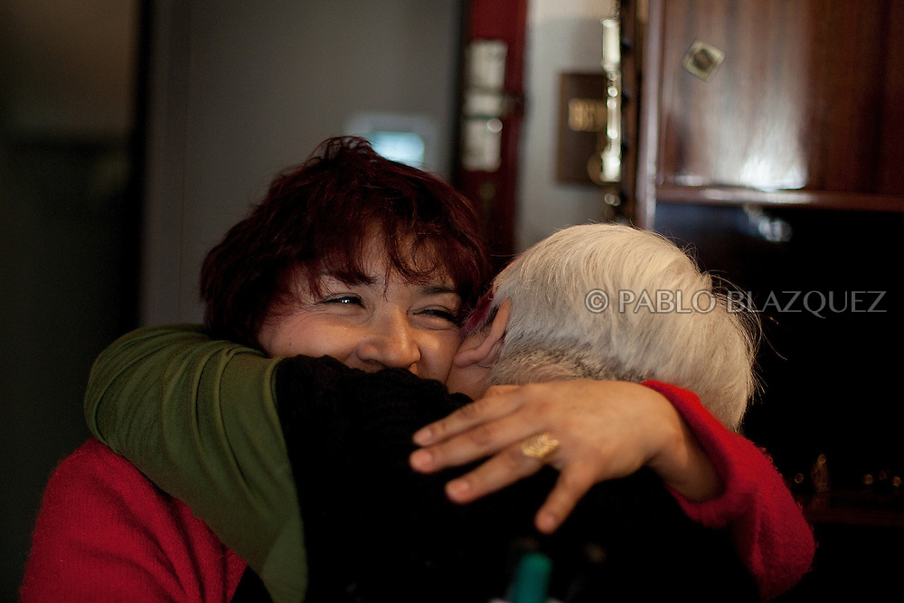 Olga Teresa Cabrera Maza embraces a woman when she learns that her eviction has been postponed for another month on February 22, 2012. Cabrera Maza, a 48-year-old immigrant form Ecuador, lives with her daughter in Madrid and started paying her mortgage on 2006 but then underwent serious health problems that let her in a permanent incapacity. Unable to work and earning a monthly pension of 600€ for her incapacity, she could not afford to pay her mortgage, which had increased from 800€ to 1890€ and stopped paying it on June 2010. She was served her first eviction notice in June 2011. The Organization Anti-evictions supported her and she finally got permission to stay at her appartment for another month. She is claiming a lieu of payment to the bank, so she can go back to her country without a debit of 250.000€, where her family will take care of her and her illness.