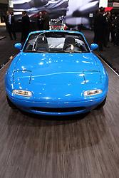 12 February 2015:   1990 mazda miata  Blue Convertible, 14th built by Mazda North America Operations.<br /> <br /> First staged in 1901, the Chicago Auto Show is the largest auto show in North America and has been held more times than any other auto exposition on the continent. The 2015 show marks the 107th edition of the Chicago Auto Show. It has been  presented by the Chicago Automobile Trade Association (CATA) since 1935.  It is held at McCormick Place, Chicago Illinois