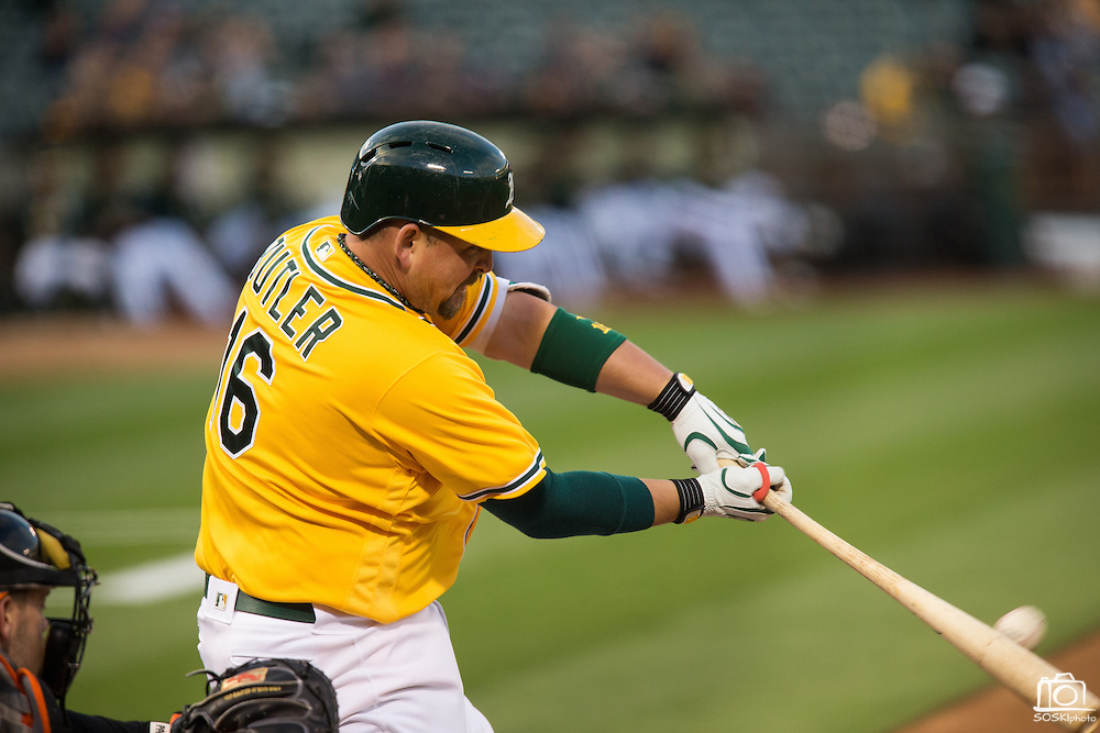 Oakland Athletics designated hitter Billy Butler (16) hits a single in the second inning against Baltimore Orioles starting pitcher Kevin Gausman (39) at Oakland Coliseum in Oakland, Calif. on August 8, 2016. (Stan Olszewski/Special to S.F. Examiner)