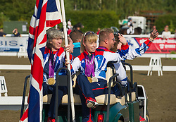 Paralympic medal-winning Equestrians Sophie Christiansen, Deborah Criddle, Sophie Wells, Natasha Baker and Lee Pearson parade at the British Dressage National Championships 2012 in Stoneleigh, Warwickshire, September 15th 2012. Photo by Nico Morgan/ i-Images.