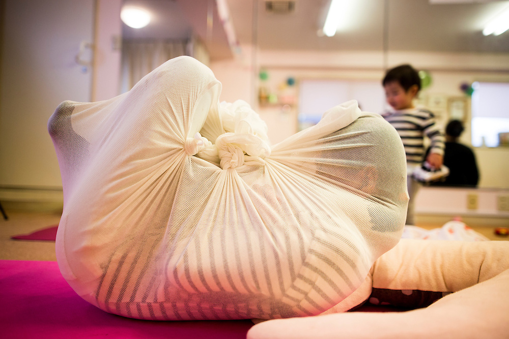 "TOKYO, JAPAN - JANUARY 29 : A woman wrapped with white cloth during a workshop called ""Otonamaki"", which directly translates to adult wrapping in Tokyo, Japan on Sunday, January 29, 2017. Otonamaki is a Japanese therapeutic method meant to alleviate posture problems and stiffness. (Photo by Richard Atrero de Guzman/ANADOLU Agency)"