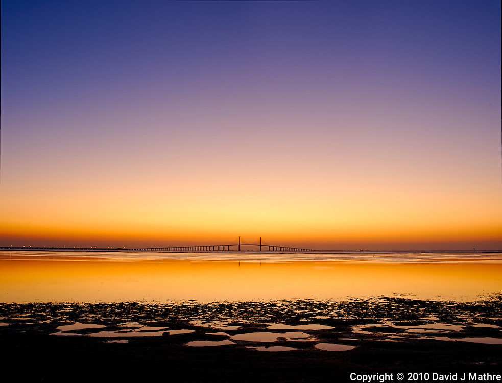 Sunshine Skyway Bridge Panorama at Dawn from Fort Desoto Park. St. Petersburg, Florida. Composite of 3 vertical images taken with an Nikon D3s and 45 mm f/2.8 PC-E lens (ISO 200, f/11, 0.5 sec). Images processed with DxO, AutoPano Giga, Photoshop CS5, and Topaz Define.