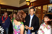 Kathy Lette and Richard E. Grant, , Kathy Lette book launch, Savoy, swimming pool 12 November 2003. © Copyright Photograph by Dafydd Jones 66 Stockwell Park Rd. London SW9 0DA Tel 020 7733 0108 www.dafjones.com
