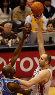 MORNING JOURNAL/DAVID RICHARD<br /> Zydrunas Ilgauskas, right, shoots over Denver's Francisco Elson last night.