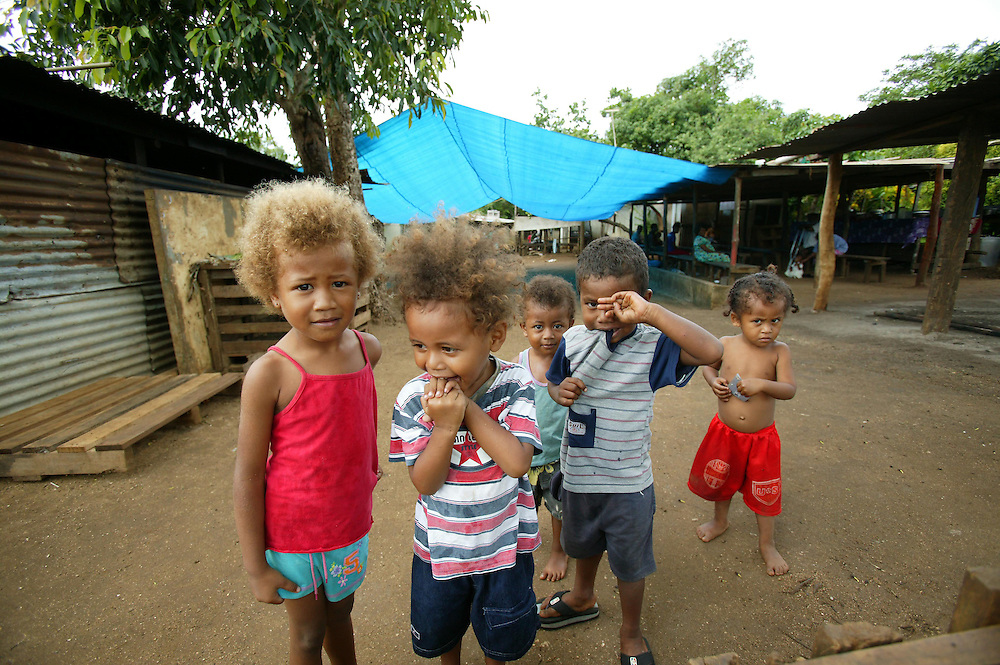 The children, are happy to pose with their friends while they play in their village, Port Vila, Vanuatu, January 30, 2006. Credit:SNPA / Rob Tucker