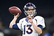 NEW ORLEANS, LA - NOVEMBER 13:  Trevor Siemian #13 of the Denver Broncos warming up before a game against the New Orleans Saints at Mercedes-Benz Superdome on November 13, 2016 in New Orleans, Louisiana.  The Broncos defeated the Saints 25-23.  (Photo by Wesley Hitt/Getty Images) *** Local Caption *** Trevor Siemian