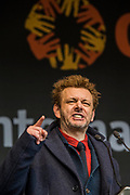 "Michael Sheen performs the ""Kier Hardie"" Speech - #March4Women 2018, a march and rally in London to celebrate International Women's Day and 100 years since the first women in the UK gained the right to vote.  Organised by Care International the march stated at Old Palace Yard and ended in a rally in Trafalgar Square."