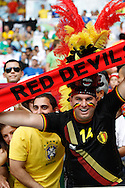 A Belgian fan wearing a red devil hat and scarf looks on during the 2014 FIFA World Cup match at Maracana Stadium, Rio de Janeiro, Brazil. <br /> Picture by Andrew Tobin/Focus Images Ltd +44 7710 761829<br /> 22/06/2014