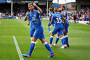 Peterborough United defender Jason Naismith (2) thanks the Luton fans for some chewing gum they threw on the pitch during  the EFL Sky Bet League 1 match between Peterborough United and Luton Town at London Road, Peterborough, England on 18 August 2018.