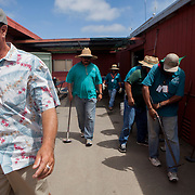 DEL MAR, CA - AUGUST 13, 2014: Leif Dickinson, turf, track and grounds superintendent for the Del Mar Thoroughbred Club, and members of the grounds crew head to set the gates on the turf track. CREDIT: Sam Hodgson for The New York Times