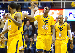 Jan 24, 2017; Morgantown, WV, USA; West Virginia Mountaineers forward Elijah Macon (45) high fives West Virginia Mountaineers forward Sagaba Konate (50) during the second half against the Kansas Jayhawks at WVU Coliseum. Mandatory Credit: Ben Queen-USA TODAY Sports