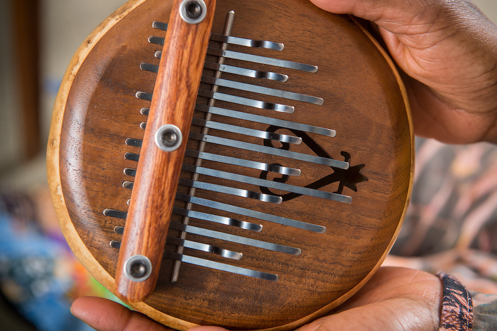 Close-up of African American hands holding a lamellophone musical instrument