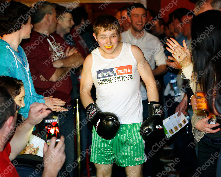 """16/03/2014<br /> Kevin """"Butcher Boy"""" McCafferty of Wolfe Tones GAA, Shannon enters the ring for his fight against Paudie """"Concussion"""" Conway of Newmarket on Fergus GAA at the White Collar Boxing tournament at the Oakwood Arms Hotel, Shannon. <br /> Picture: Don Moloney / Press 22"""