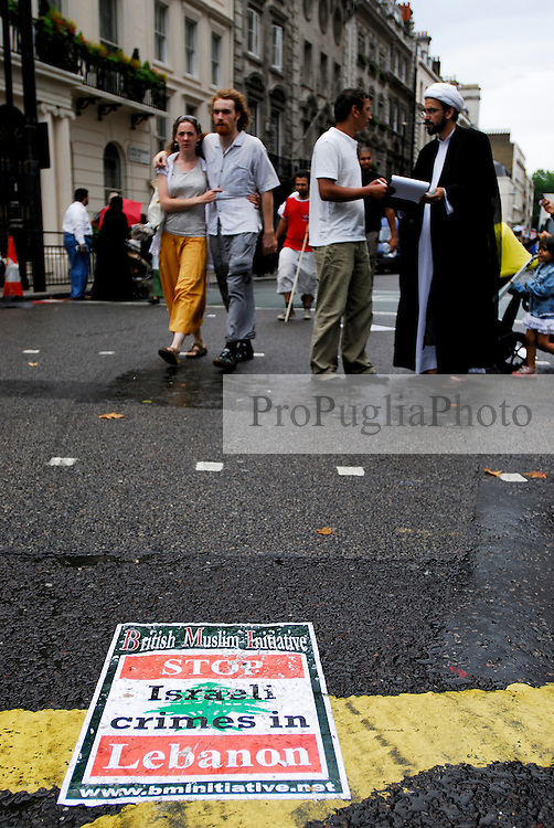"""LONDON 22 July 2006. Over 7,000  people joined a street protest against Israel's attacks on Lebanon.. """"The Israeli assault is now spreading to all regions including the mountains and the north. The damage is enormous and the death toll is rising. This only indicates the scale of the attacks and the advanced weaponry the Israelis are using. Only looking at the infrastructure ruins you can see how powerful they are. We are under siege from all directions - air, sea and land."""" Eyewitness account from a socialist in Lebanon.PHOTO © KASH GT.Distribution NORTH & SOUTH AMERICA ONLY"""